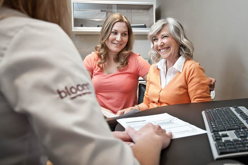 Hearing aids consultant helping hearing loss patient