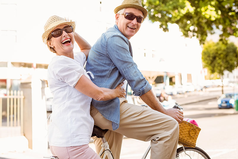 Man and woman on bike with hearing aids